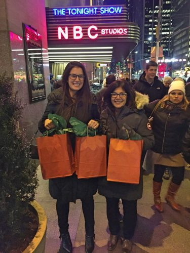 Showing off our Christmas gifts from Jimmy Fallon in New York City