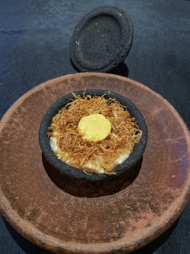 A rice dish resembling a bird nest with a yolk at Namaaz Dining